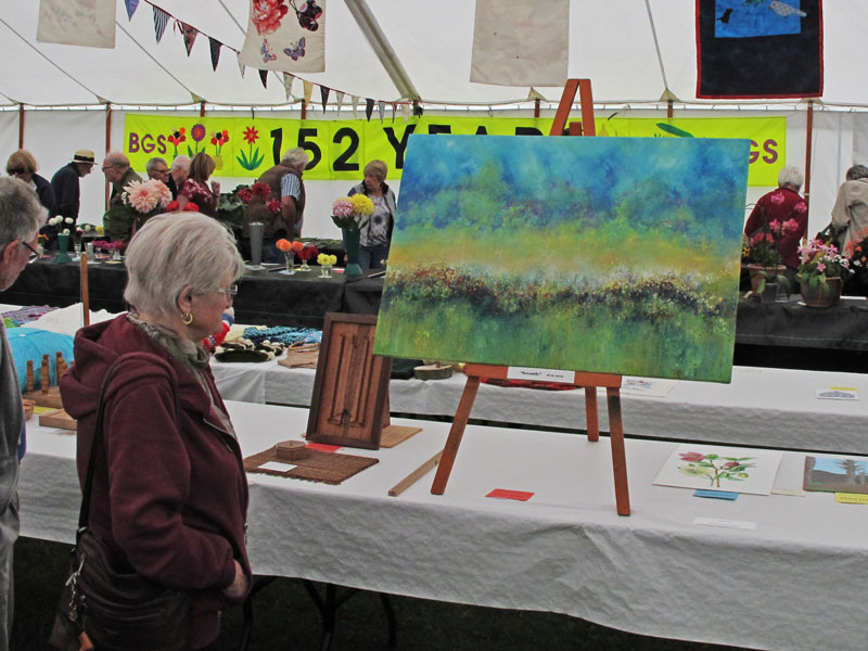 A photo of a painting at the show