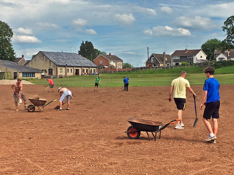 Volunters work on the sports grounds